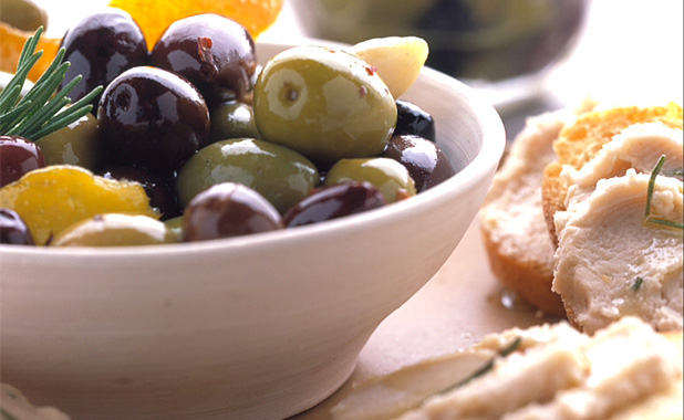 Locally harvested olives and humus on toasted bread