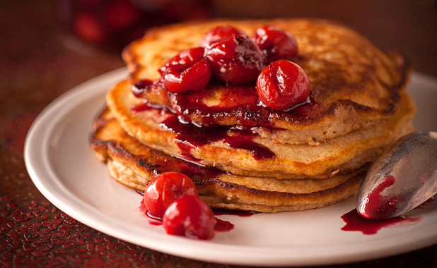 Pancakes with sour cherry sauce