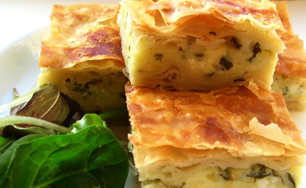 Layered pastries with feta cheese and parsley