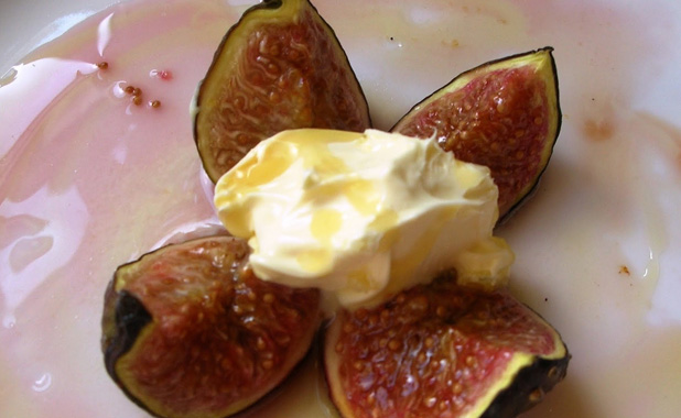 Fig with clotted cream and drizzled with honey