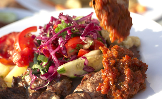 Kebab plate with salad and Ezme, a spicy tomato tapenade.