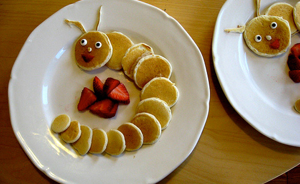 Caterpillar pancakes with strawberries