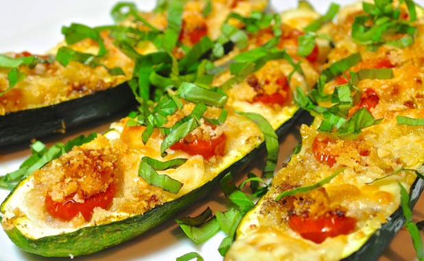 Courgettes filled with tomato and cheese, and grilled for a crunchy crispy topping