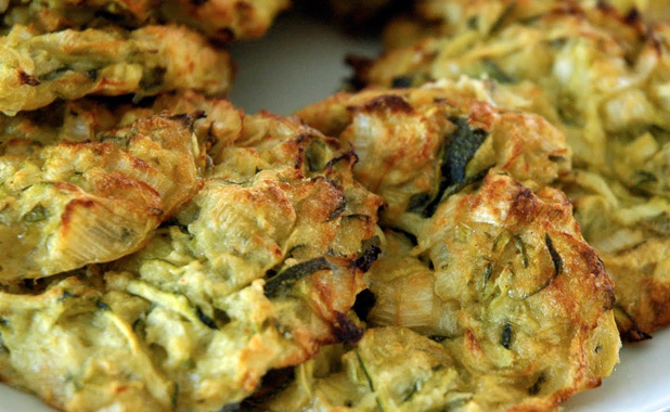 Zucchini and herb fritter served with creamy yogurt